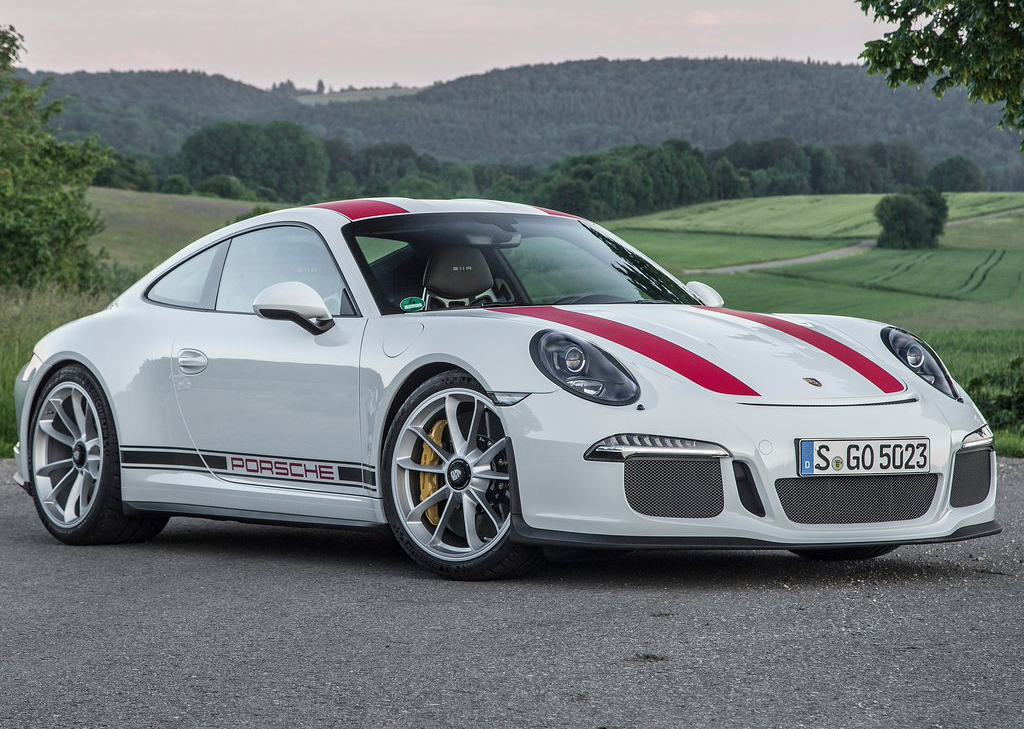 this white 911 r with optional red racing stripes is on sale somewhere in miami florida